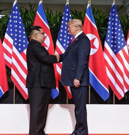 kim-and-trump-shake