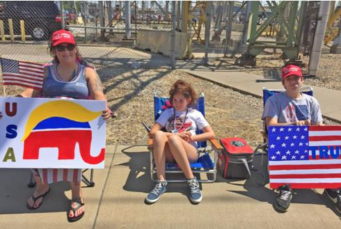 Sara Cox and her children wait at the gates of U.S. Steel in Granite City to welcome President Trump.
