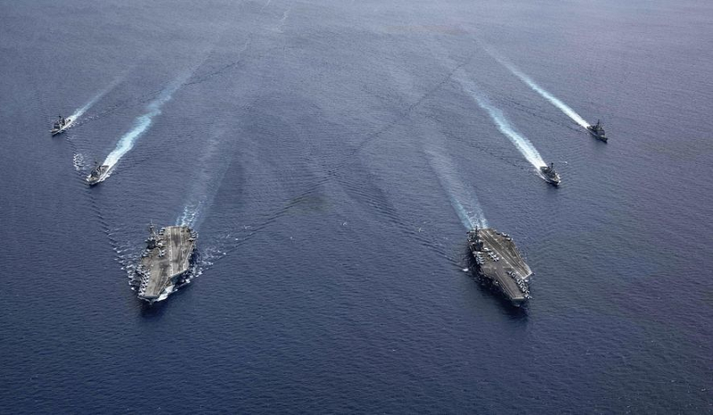 USS Ronald Reagan and USS Nimitz Carrier Strike Groups steam in formation in the South China Sea (7/06)